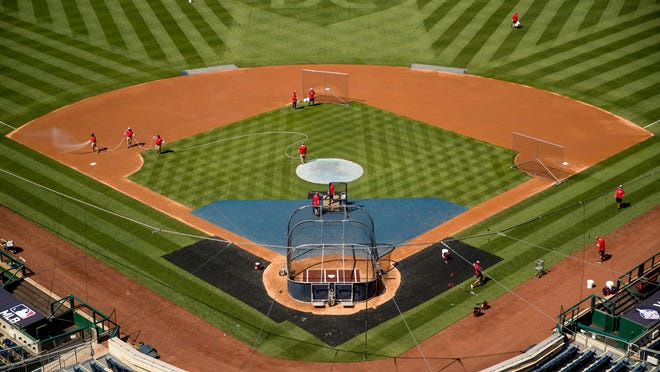 """A heart is visible in center field with the letters """"DC"""" as the Nationals hold their first baseball training camp workout in Washington."""