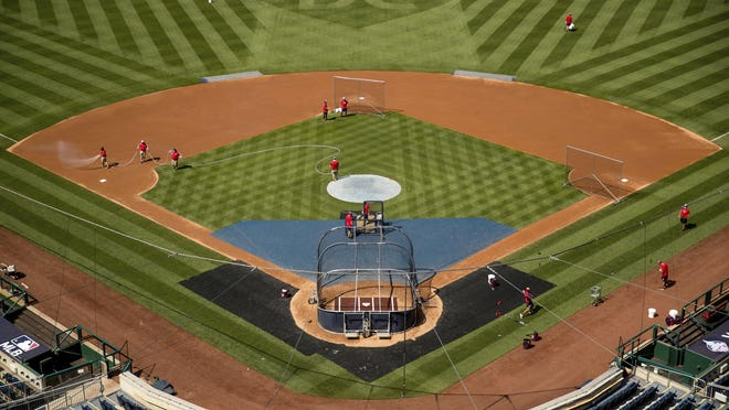 """A heart is visible in center field with the letters """"DC"""" as the Washington Nationals hold their first training camp work out at Nationals Stadium on Friday in Washington."""