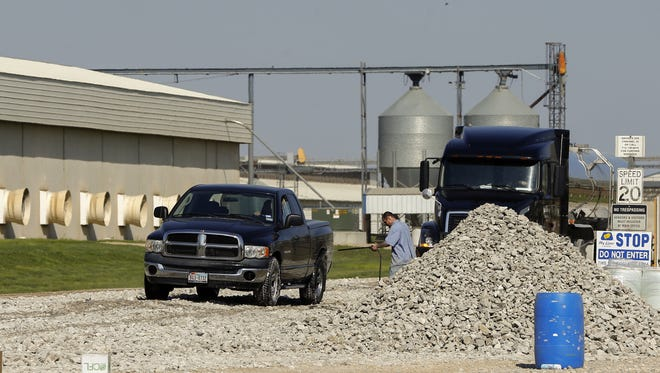 Trucks are sprayed with disinfectant before leaving Sunrise Farms in Harris Iowa, the nation's largest egg-laying facility Thursday, April 23, 2015. The 3.8 million chickens at the facility will be destroyed after the H5N2 bird flu virus was found.