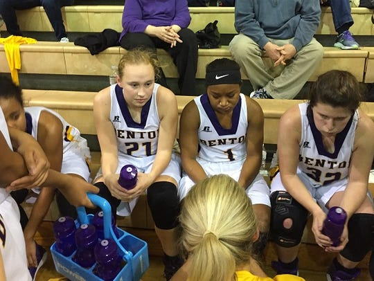 Benton coach Mary Ward talks to her charges during
