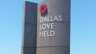 A sign welcomes travelers to Dallas Love Field.