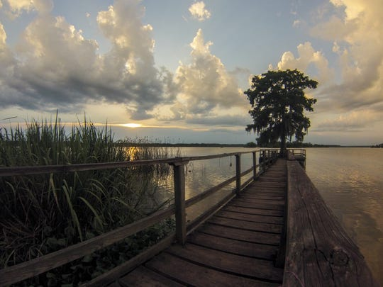 The sun sets on Island Outpost in Lake Fausse Pointe State Park near Loreauville, LA, Thursday, July 3, 2014.