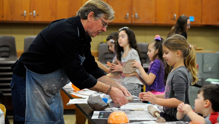 Mike Bladow teaches a clay for kids class during free college day Saturday, Mar. 25, 2017, at St. Clair County Community College.