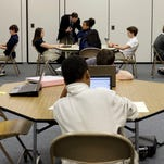 Seventh-grade students take part in a trial run of a state assessment test in Annapolis, Md.
