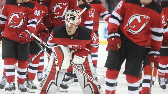 Cory Schneider and his team leave the ice after their
