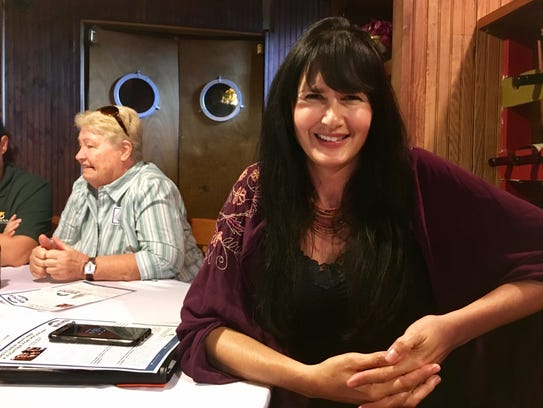 Laura Kotasek, 45, of Oxford attends a meeting of the