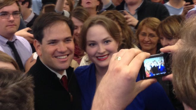 Florida Senator Marco Rubio is surrounded by a crowd during a campaign event Friday in Sioux City.