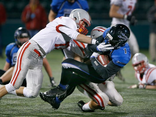 Section V Class A - Canandaigua's Mike Zimmerman contributes to bring down Brockport's Cory Gross in the second quarter.