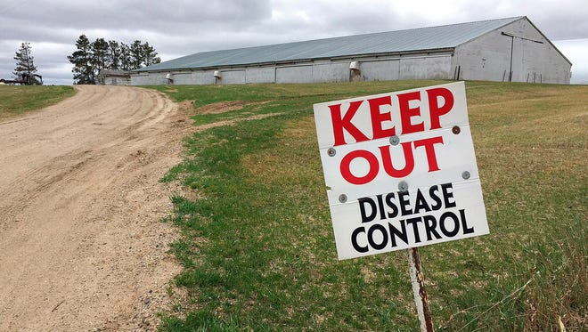 In this 2015 file photo, a sign warns visitors to stay away from an infected turkey farm.