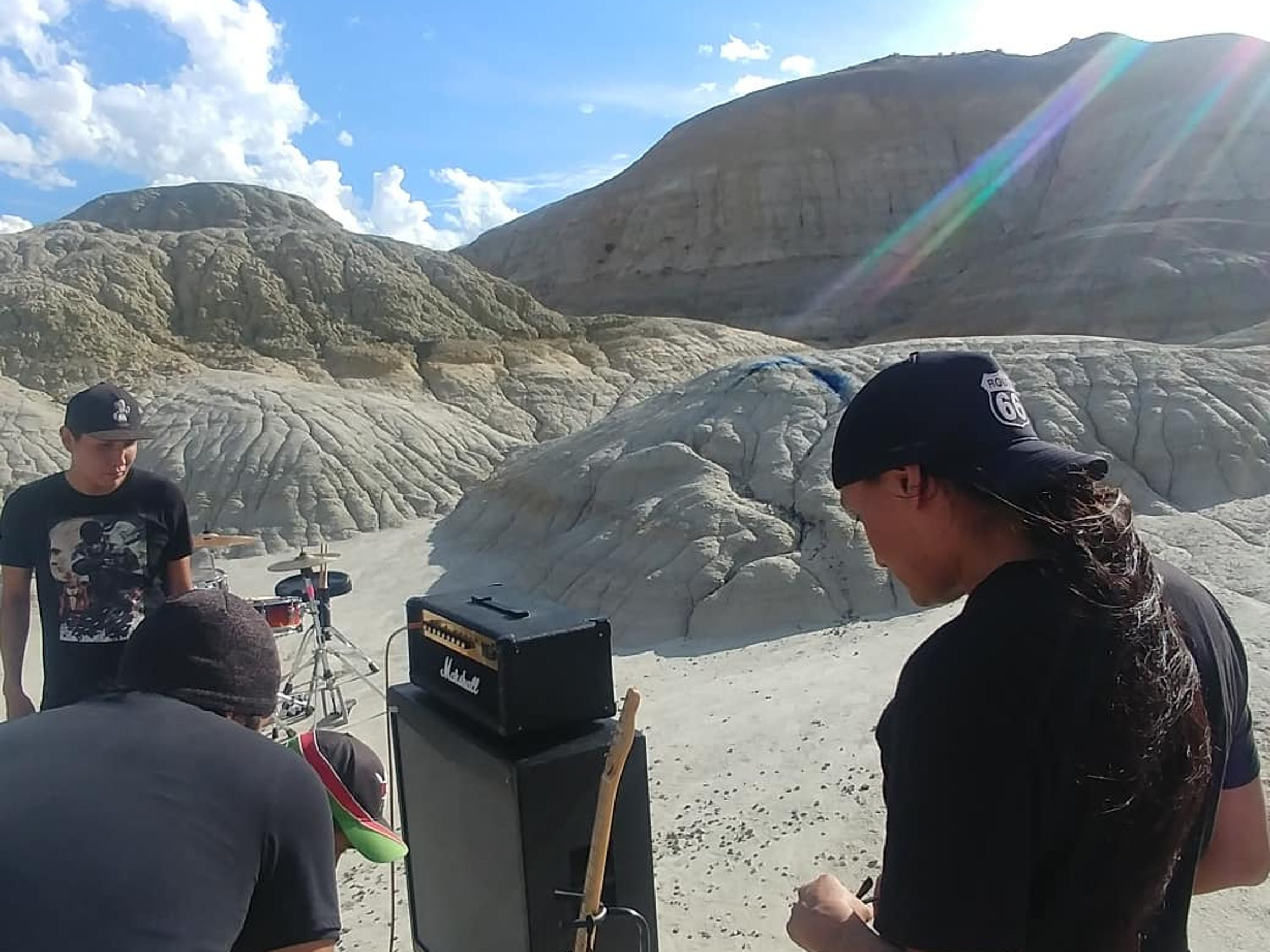 "Cinematica guitarist Brandon Mike, left, reacts during the filming of the band's video for the single ""Galaga."""