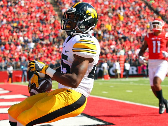 Sep 24, 2016; Piscataway, NJ, USA;  Iowa Hawkeyes running back Akrum Wadley (25) runs for a touchdown during the second half at High Points Solutions Stadium. Iowa defeated Rutgers 14-7.  Mandatory Credit: Ed Mulholland-USA TODAY Sports
