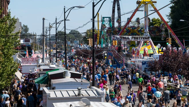 People attend the 96th annual West Side Nut Club Fall Festival along West Franklin Street in Evansville, Ind., around lunchtime on Monday, Oct. 2, 2017. The street festival will continue all week long until late Saturday evening, October 7.