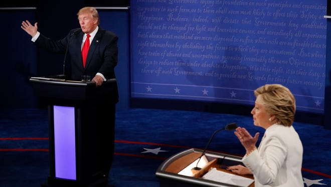 Democratic presidential nominee Hillary Clinton and Republican presidential nominee Donald Trump debate during the third presidential debate at UNLV in Las Vegas on Oct. 19.