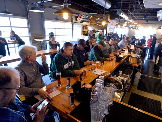 Beer lovers hit the bar at the grand opening of the