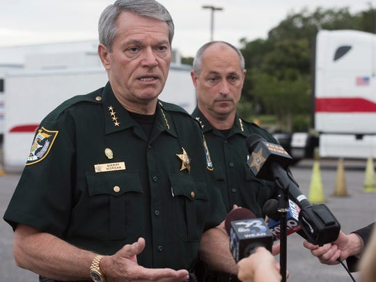 Escambia County Sheriff David Morgan, left, updates members of the media on the ongoing search for Naomi Jones during a press conference at Olive Baptist Church Monday morning June 5, 2017.