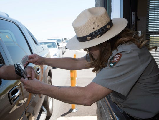 Stace Wilson, with the National Parks Service, compares