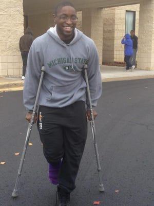Alexander Jones of Farmington Hills didn't let a cast and crutches keep him from the polls Tuesday.