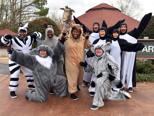 """Members of the New Stage Theatre cast of """"Madagascar: The Musical Adventure"""" pose in costume at the Jackson Zoo."""