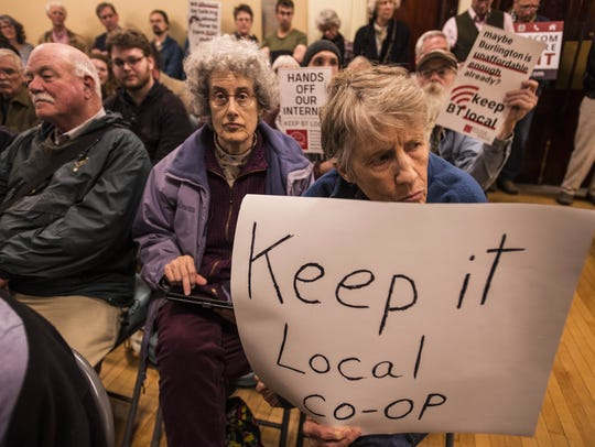 "Mary Donnelly of Burlington holds her ""Keep It Local"