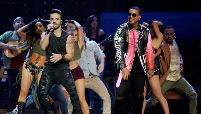 Luis Fonsi, left and Daddy Yankee perform 'Despacito' during the Latin Billboard Awards.