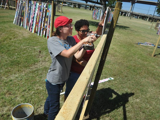 Audra Lambert, left, and Whitney Hogue work together