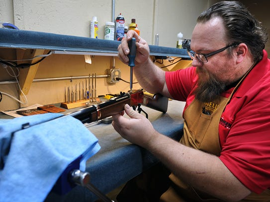 Mike Stephens, a gun smith for Marksman Firearms and