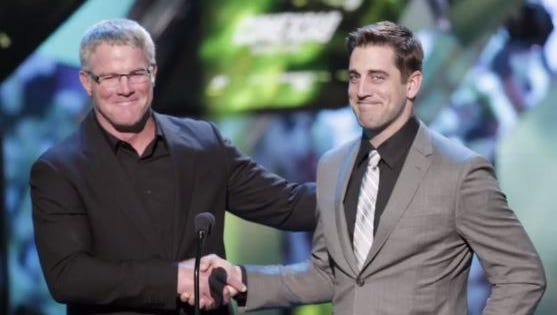 Brett Favre and Aaron Rodgers present at the NFL Honors on Feb. 2, 2013.