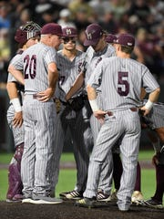 Mississippi State head coach Gary Henderson confers with pitcher Konnor Pilkington (48) at the NCAA Super Regional Saturday June 9, 2018, at Hawkins Field in Nashville, Tenn.
