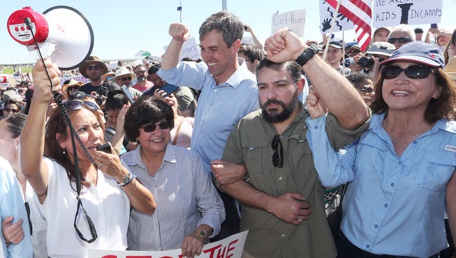 Democratic political leaders, including former El Paso County Judge Veronica Escobar, from left, gubernatorial candidate Lupe Valdez, U.S. Rep. Beto O'Rourke and state Reps. César Blanco and Lina Ortega, lead hundreds of marchers to the gates of the Tornillo-Guadalupe port of entry, where undocumented immigrant children were being housed in a tent city Sunday east of El Paso.