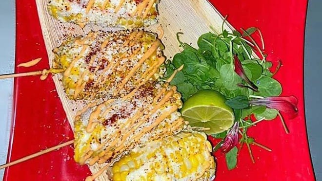 Elote Loco is grilled corn drizzled with mayonnaise, chili powder, cotija, mustard and lime that will be on Lola's menu.