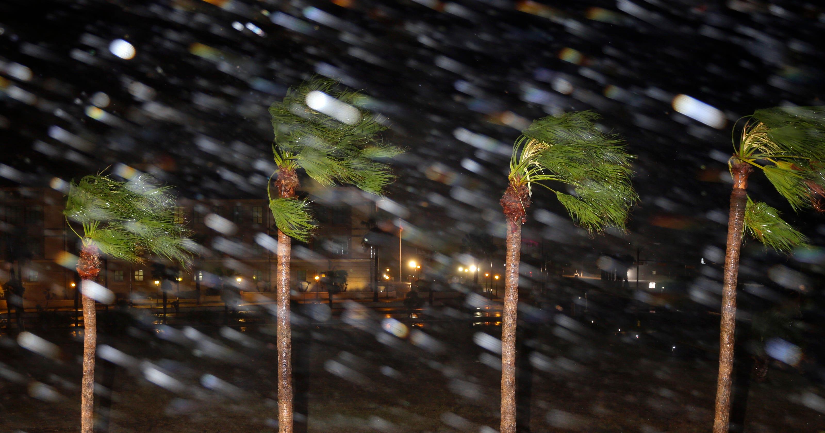 Hurricane Harvey pounds Texas, downgraded to Category 2 storm