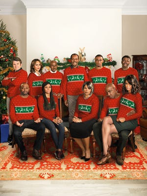 """Director David E. Talbert used this Christmas sweater-filled image to promote 'Almost Christmas.'  He explains, """"Because we ran out of money in our wardrobe budget. The swap meet was open and they were the only things we could afford."""""""