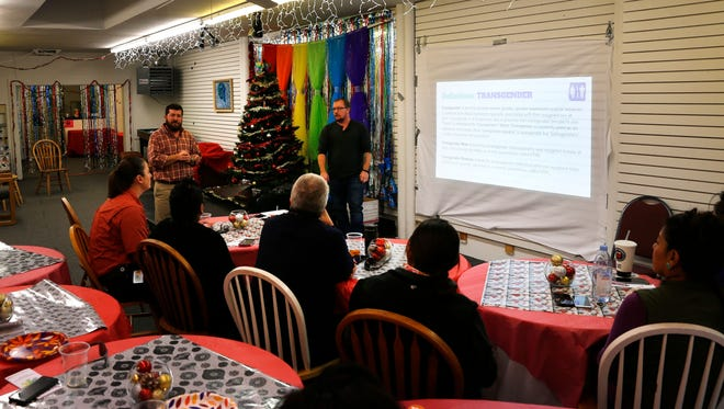 Community members attend a training session led by Transgender Resources Center of New Mexico officials on Dec. 23 at the Identity Inc. community center in Farmington.