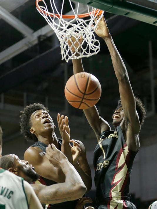 Florida State forward Jonathan Isaac (1) dunks against Miami in the second half of an NCAA college basketball game, Wednesday, Feb. 1, 2017, in Coral Gables, Fla. Florida State won 75-57. (AP Photo/Alan Diaz)