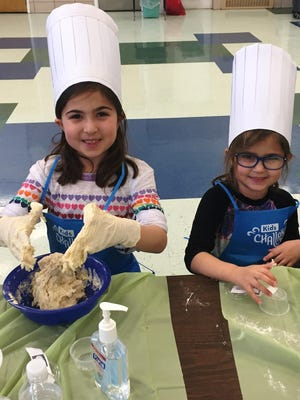 Leah and Emma Thomas participated in a previous Kids' Challah Mega Bake at Chabad of Goshen. This year's challah bake is Feb. 9 in Chester.