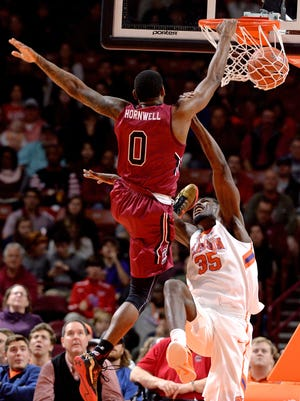 South Carolina guard Sindarius Thornwell (0) dunks over Clemson center Landry Nnoko (35) during the 1st half Friday, December 18,  2015 at Bon Secours Wellness Arena in downtown Greenville. BART BOATWRIGHT/Staff
