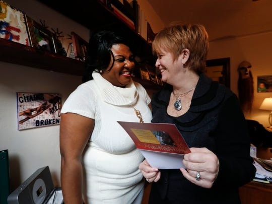 Lucy Neighbor laughs with Deborah Drennan, Freedom House's executive director.