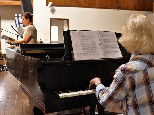 """Vocalist Amber Jones, left, and director Linda Edwards rehearse Wednesday at RiverStone Church as they prepare for a performance of """"Stabat Mater"""" March 30-31 at the church."""