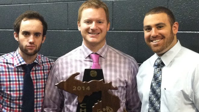 Farmington's new co-head coaches Christopher Gendron (center) and Brad Levick (right) are pictured with former fellow assistant hockey coach Chris Newton and the 2014 state championship trophy.