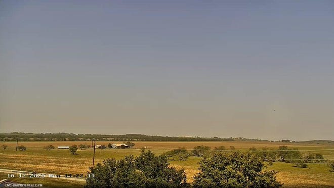 National Weather Service officials said a cold front that moved through Central Texas on Monday caused hazy skies in multiple counties because of dust being carried over from states like Kansas and Oklahoma.