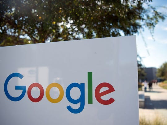 A Google sign and logo at the Googleplex in Menlo Park,