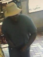 Surveillance image of a man accused or robbing a Subway