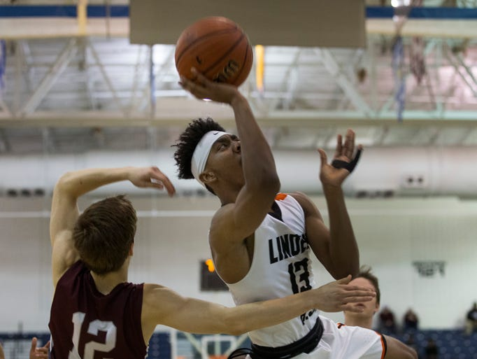 Linden's Tavon Jones goes up with a shot early in the
