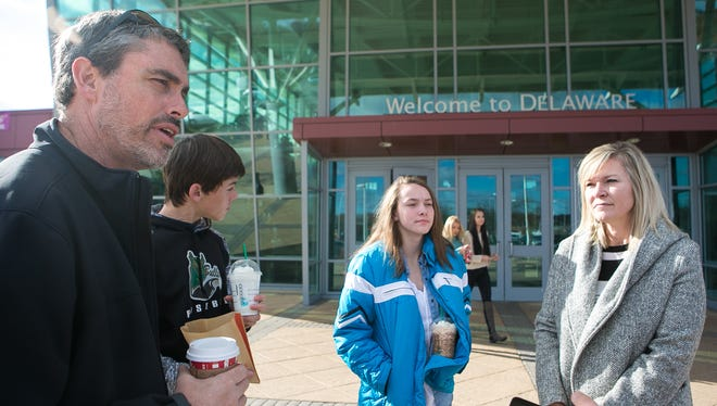 Dan Malone (left) and Amy Malone (right), from New Braunfels, Texas, stop at the Welcome Center in Delaware with there children. They are headed to Washington, D.C., after visiting family in Allentown.