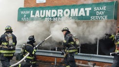 Firefighters battle a blaze at a laundromat in Bergenfield