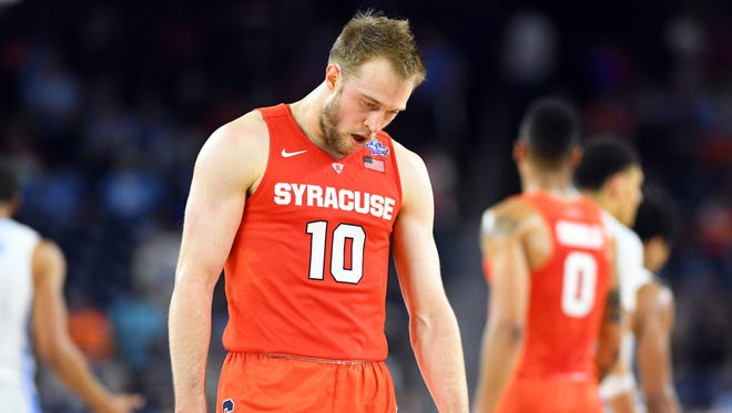 Syracuse Orange guard Trevor Cooney (10) reacts during the second half against the North Carolina Tar Heels in the 2016 NCAA Men's Division I Championship semi-final game at NRG Stadium.