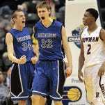 Greensburg High School's Ryan Welage (32) and Sean Sellers (34) react to a foul call in front of Bowman Academy's Arthur Haggard III (2) during the first half of the IHSAA Class 3A Indiana state boys' basketball championship game in Indianapolis, Saturday, March 29, 2014.