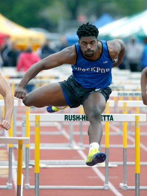 Brockport's Jayon Frater wins the 110m hurdles during the track meet at Rush-Henrietta High School.