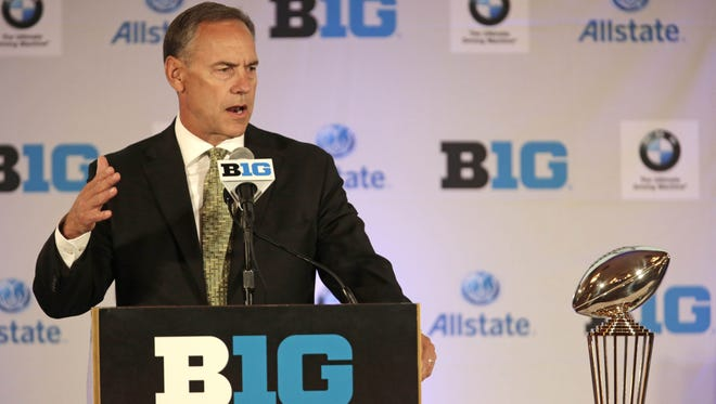 Michigan State coach Mark Dantonio talks to reporters Wednesday on the first day of the Big Ten football media days in Chicago.   AP Michigan State head football coach Mark Dantonio listens to a question during a news conference at the Big Ten football media day Wednesday, July 24, 2013, in Chicago. (AP Photo/M. Spencer Green)