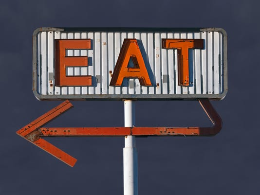 Vintage Eat Arrow Sign with Storm Sky